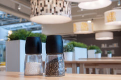 Salt and pepper in the restaurant interior Royalty Free Stock Photo
