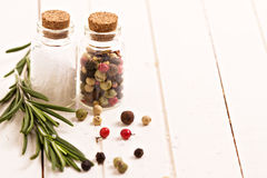 Salt, pepper and rosemary Royalty Free Stock Photography