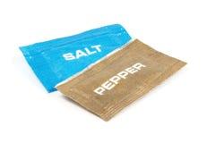 Salt and pepper sachets Stock Photos