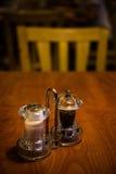 Salt and pepper in shaker glass bottle Royalty Free Stock Image