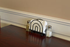 Salt and pepper shaker and napkin dispenser Royalty Free Stock Photography
