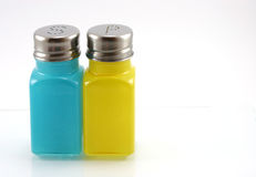 Salt & Pepper shakers. Salt &pepper shakers made from glass on withe Royalty Free Stock Photo