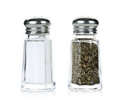 Salt and pepper shakers. Glass salt and pepper shakers isolated on white background royalty free stock photography