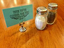 Salt and pepper shakers at diner royalty free stock photos