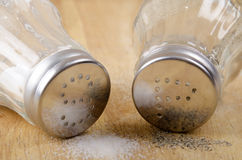 Salt and pepper shakers on wood Stock Photo