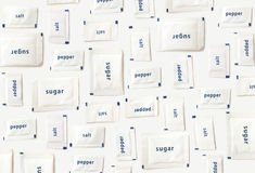 Salt, pepper and sugar sachets pattern background Royalty Free Stock Image