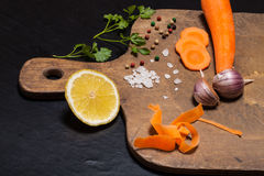 Salt, pepper and vegetables on old wood background Royalty Free Stock Image