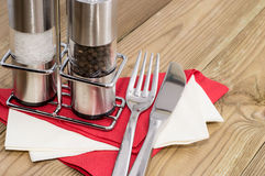 Salt- and Peppershaker with cutlery Stock Photo