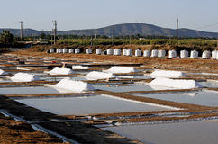 Salt Piles. And bags on the salines near Olhão, Portugal Royalty Free Stock Image