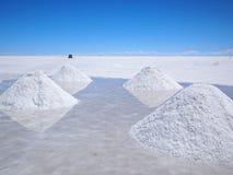 Salt piles with reflection on the salar Stock Photos