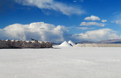 Salt piles on Salar Uyuni salt lake Royalty Free Stock Images