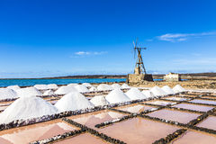 Salt piles in the saline of Janubio in Lanzarote with old toteen Royalty Free Stock Images