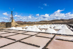 Salt piles in the saline of Janubio in Lanzarote with old toteen Stock Photography