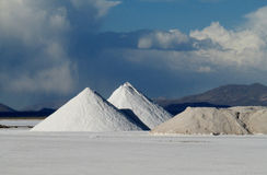 Salt piles on salt lake near the salt production mine Stock Photo