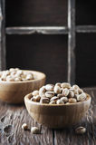 Salt pistachio nuts in the wooden bowl Stock Photos