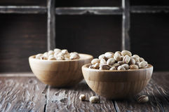 Salt pistachio nuts in the wooden bowl Stock Images