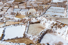 Salt ponds of Maras, Peru. Salt ponds in Maras Peru covering a hillside with rich minerals and a economy boost for the country and people Stock Photo