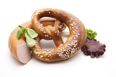 Salt pretzel and lettuce leaf Stock Photography