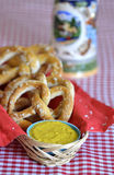 Salt Pretzels with Mustard Beer Stein on Red Checker Tablecloth Royalty Free Stock Image