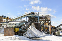 Salt processing. Salt is produced from salt mines or by the evaporation of seawater or mineral-rich spring water in shallow pools Stock Images