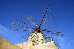 Salt production. Windmill in the area of salt production in Salemi near Marsala, Sicily Stock Photos