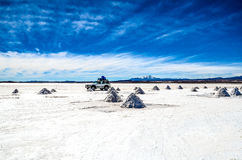 The Salt Pyramids, Salt Desert, Bolivia. Car stopped in the middle of the salt piles Royalty Free Stock Photography
