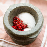 Salt and redberry marinade in mortar Stock Photos