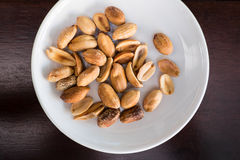 Salt roasted peanut in white plate Royalty Free Stock Image
