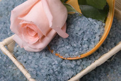 Salt and rose. Lot of blue salt as backgrounds and beauty pink rose Stock Photography