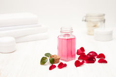 Salt, rose water from rose petals with your hands on a white woo Stock Photography