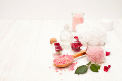 Salt, rose water from rose petals with your hands on a white woo Royalty Free Stock Image