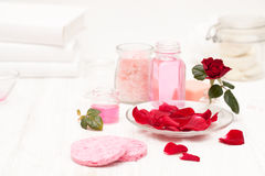 Salt, rose water from rose petals with your hands on a white woo Royalty Free Stock Photos