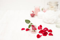 Salt, rose water from rose petals with your hands on a white woo Stock Images