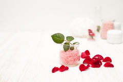 Salt, rose water from rose petals with your hands on a white woo Stock Photo