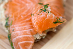 Salt salmon. Salty fish salmon on a bread Royalty Free Stock Image
