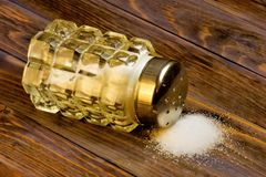 Salt in the salt shaker is a food product, widely used in cooking. Salt is a symbol of spiritual food. Well-known custom to meet. Guests with bread and salt. In stock images