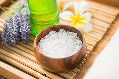 Salt scrub and oil massage. On a bamboo mat royalty free stock photo