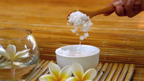 Salt scrub pouring into bowl at the spa