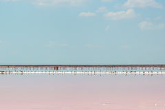 Salt sea water evaporation ponds with pink plankton colour Royalty Free Stock Image