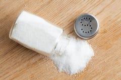 Salt shaker. Photo shot of salt shaker on wooden table royalty free stock image