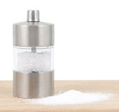 Salt shaker. On cutting board with salt Stock Image