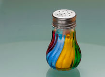 Salt shaker made of coloured glass stock photos