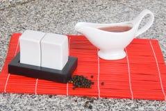 Salt shaker, pepper pot and vinagreta pitcher Royalty Free Stock Photos