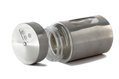 Salt shaker with a perforated lid,lying.Insulated Stock Photography
