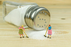 Salt Shaker and Spilled Salt Stock Photo