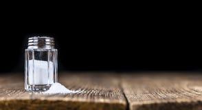 Salt Shaker (on vintage background) stock images