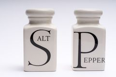 Salt shaker, white with black letter royalty free stock image