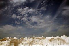 Salt and a sky. Picks of salt mountains in a east of Majorca in Spain stock photos