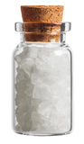 Salt spice in a little bottle isolated on white Stock Photo