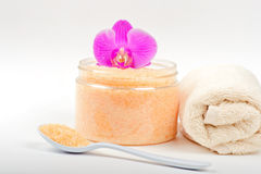 Salt, spoon, towel and orchid Royalty Free Stock Photo
